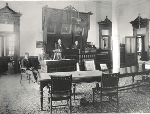 Deputy Clerk F. T. Connerly, Clerk Charles S. Morse, with Court. Undated. Photo: Austin History Center.