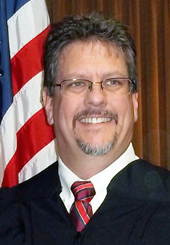 Photo of Justice Gregory T. Perkes